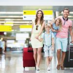happy-family-suitcases-airport