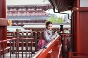 tourist  with camera in Japanese temple